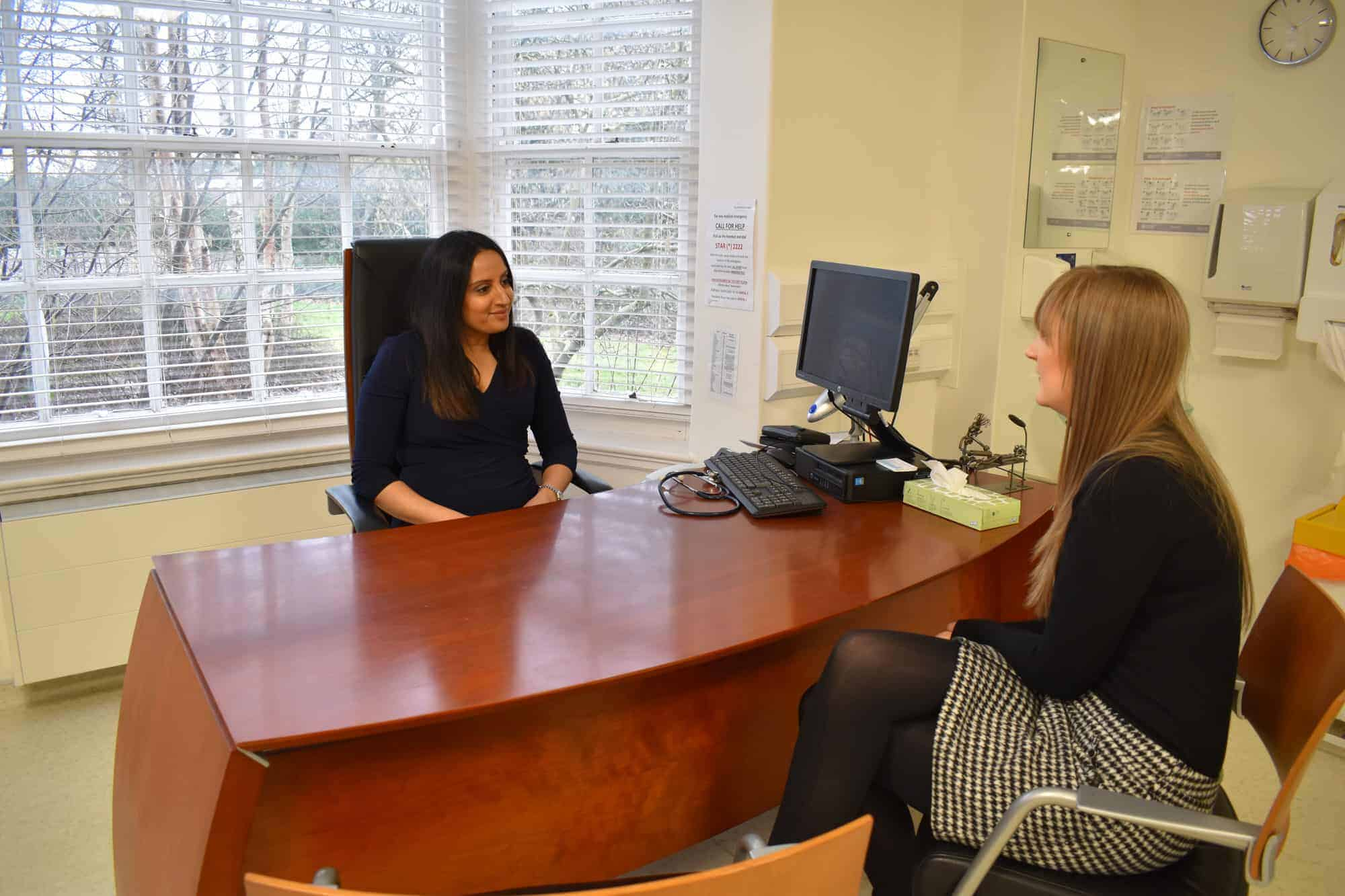 Doctor Rupa discussing medical and corporate services with a client