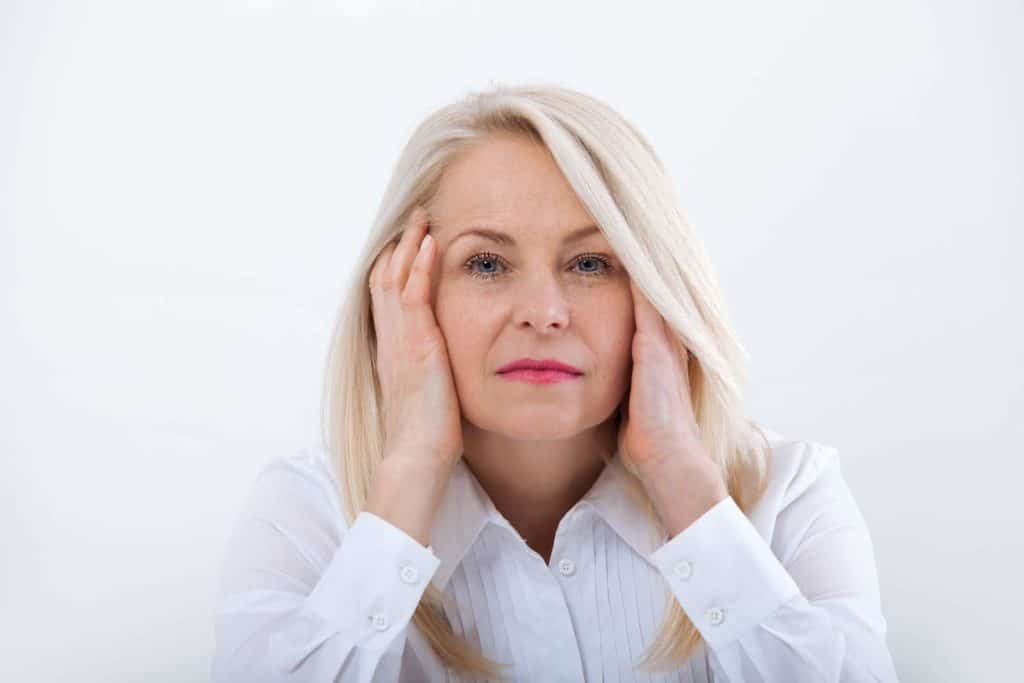 woman experiencing symptoms of menopause